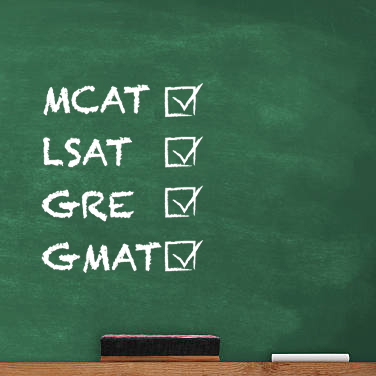 MCAT, LSAT, GRE, and GMAT written on chalkboard